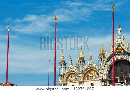 Basilica di San Marco (Saint Mark's Basilica) on the blue sky background in Venice Italy. Basilica di San Marco is the main tourist attraction of Venice.