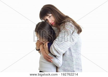 young tender mom hugs her child in Studio isolated on white background