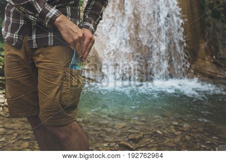 Unrecognizable Man Standing With Travel Map In Pocket Hiking Travel Tourism Concept