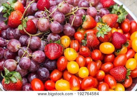 Close-up On Fresh And Sweet Organic Grapes, Strawberries, Cherry Tomatoes