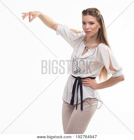 Young happy woman portrait of a confident businesswoman showing presentation, on a gray background. Ideal for banners, registration forms, presentation, landings, presenting concept..