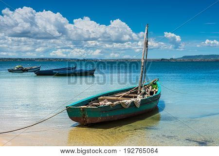 Malagasy wooden sail boat on the sea coast Madagascar