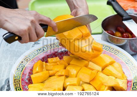 Hand Holding Knife Cutting Sweet Delicious Organic Mango