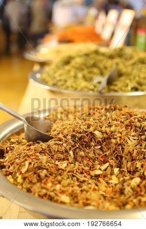 A variety of spices, seasonings, teas on the counter in a specialized shop