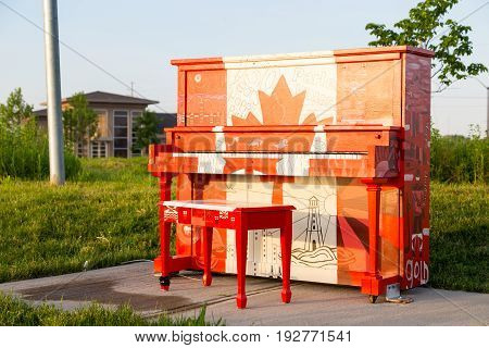 London Ontario Canada-June 3 2017: The Hyde Park outdoor Piano painted by the students of Oakridge secondary school in the theme of our Canadian 150 year celebration.