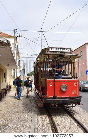 Sintra Street Scene With Old Red Tram, Portugal