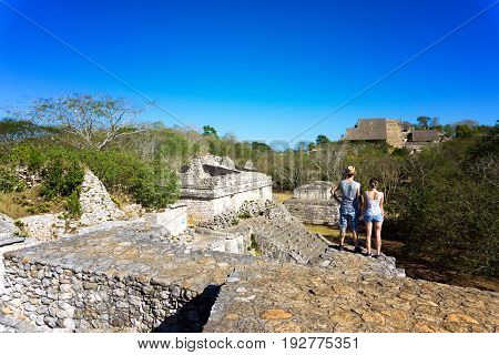 EK BALAM MEXICO - FEBRUARY 12: Tourists look at the ancient Mayan ruins of Ek Balam on February 12 2017
