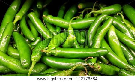 Group of fresh and raw green Serrano Peppers