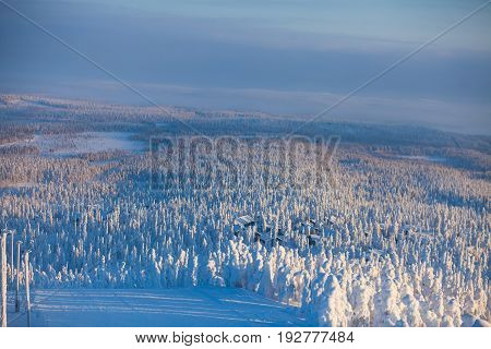 Beautiful cold mountain view of ski resort, sunny winter day with slope, piste and ski lift