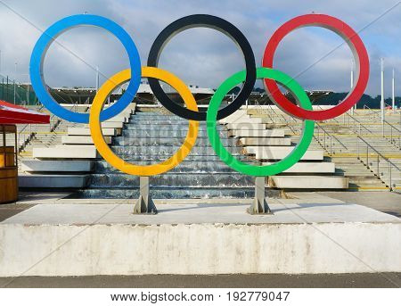 Sochi RUSSIA - May 30 2017: Blue sky fontain and symbol of Olympic Games 2014 in Sochi