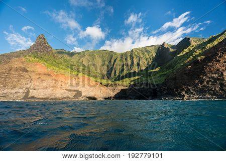Ka'a'Alahina Ridge on Na Pali coastline in Kauai from sunset cruise