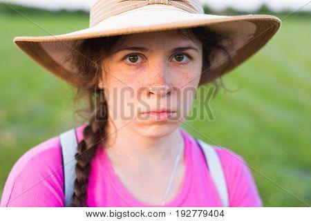 Close up portrait sad woman with freckles.