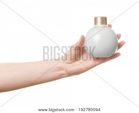 Female hand with bottle of cream for using after shower, on white background