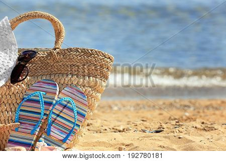 Beach accessories on sand at sea shore. Vacation concept
