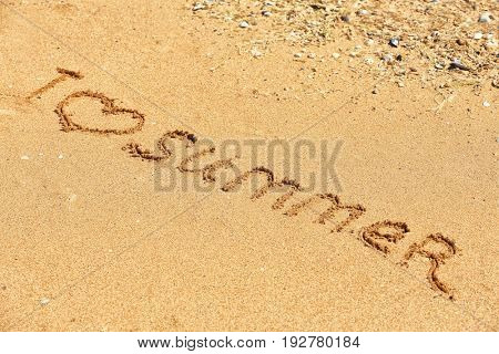 Phrase I LOVE SUMMER written on beach sand. Vacation concept