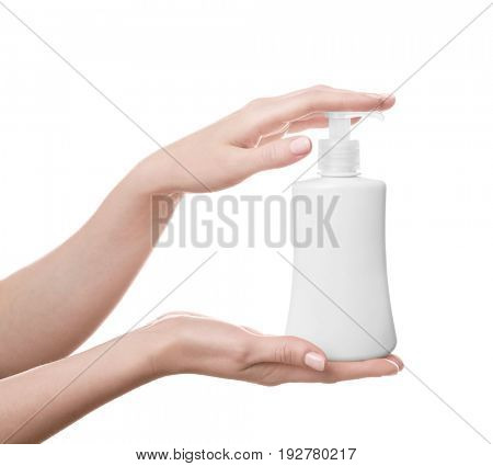 Female hands with bottle of cosmetic product for shower on white background