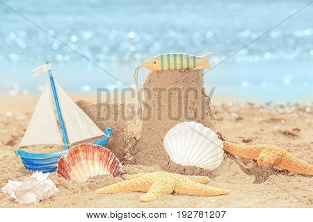Composition with sand and shells on sea shore. Vacation concept