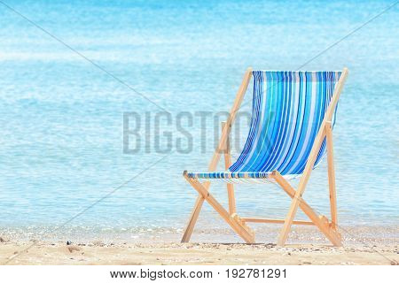 Comfortable beach chair at sea shore. Vacation concept