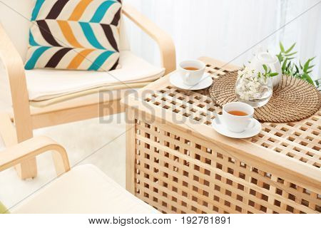 Wooden coffee table in modern veranda interior