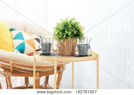 Beautiful modern veranda with cozy armchair and coffee table