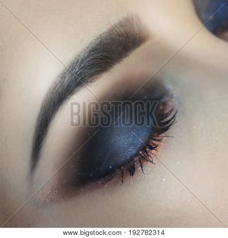 Close up of female closed eye with beautiful make up