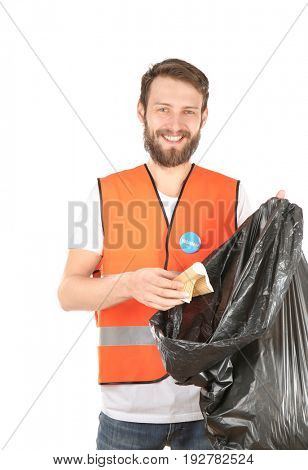 Handsome young volunteer with garbage bag on white background