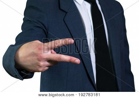 Young businessman in jacket and white shirt shows gestureVictory with two fingers. Business concept, focus on hand. V sign victory.