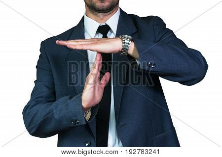 Young businessman in jacket and white shirt shows doing time break gesture. Business concept, focus on hand