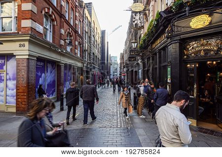 LONDON, UNITED KINGDOM - APRIL 16: Unidentified people in public Covent Garden market hall, preferred meeting point and shopping mall, inLondon, England