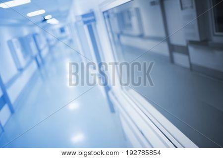 Long hallway of medical building unfocused background.