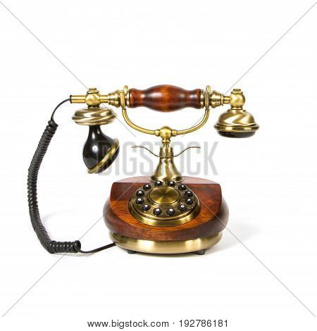 Vintage wooden telephone isolated over white background