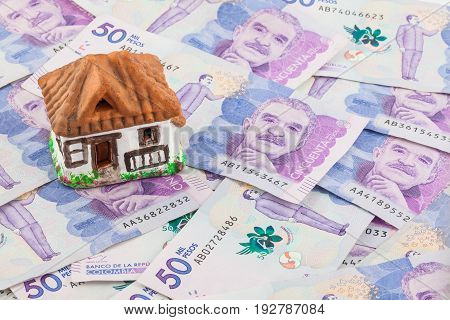 Saving Fifty Thousand Colombian Pesos Bills to buy a house