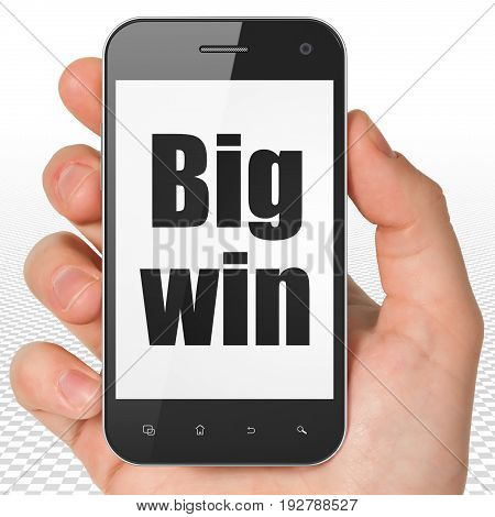 Business concept: Hand Holding Smartphone with black text Big Win on display, 3D rendering