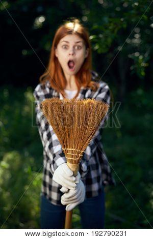 Emotions, broom, woman in the garden, gardener, summer, harvesting.