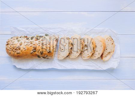 Fresh Sliced Mixed Seed Baguette On The Wooden Table, Top View