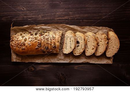 Fresh Sliced Bread On The Dark Wooden Background Top View