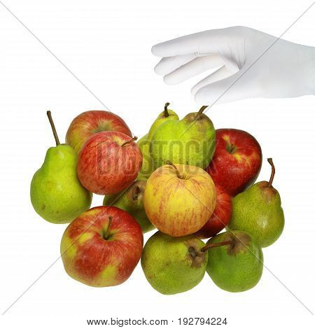 A hand in a white glove grabs a fruit.