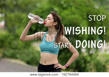 Fitness quotes. Text STOP WISHING, START DOING on background. Young woman drinking water after run in park
