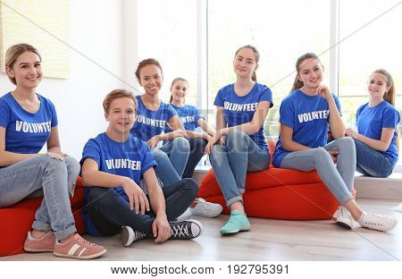 Meeting of young volunteers team indoors