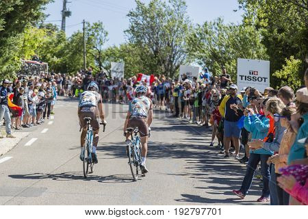 Mont Ventoux France - July 142016: The cyclists Ben Gastauer and Cyril Gautier of AG2R La Mondiale Team riding on the road to Mont Ventoux during the stage 12 of Tour de France 2016.