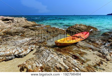 holiday beach with boat sea and sky