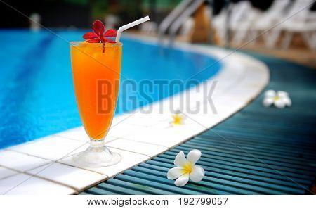 Swiming pool drink orange juice fresh for drink