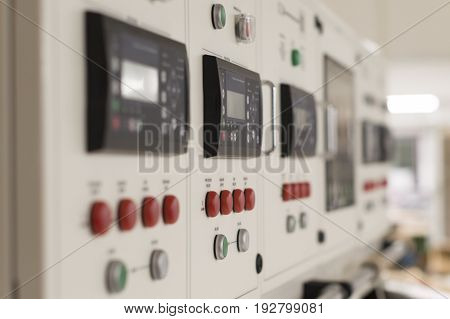 Main electric control board inside a factory (blurred picture)