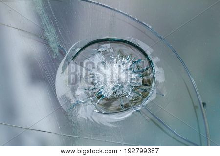 Bulletproof glass background bullethole from the bullets cracks and broken. Criminal concept