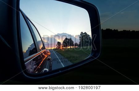 Colorful Sunset reflecting in the side view mirror