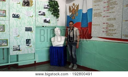 Photographer in the Russian school.General-lieutenant Stepan Dorokhov sculpture in the scool.Founder of Soviet anti-ballistic missile testing range Sary Shagan at 1956.May 6, 2017.Priozersk.Kazakhstan