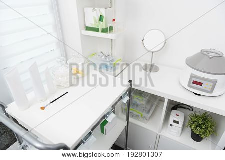Beauty salon. Top view of modern workplace of professional beautician with specialized instruments