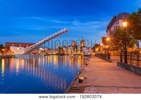 Old town in Gdansk and catwalk over Motlawa river at dusk, Poland
