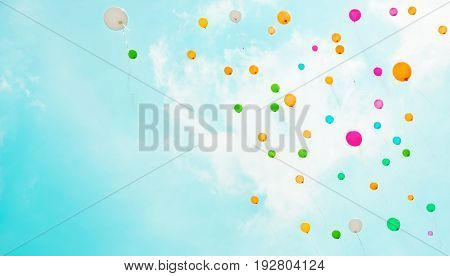 Beautiful background with multicolored flying balloons in blue sky. The concept of happiness joy freedom. Holiday Web Banner With Copy Space.