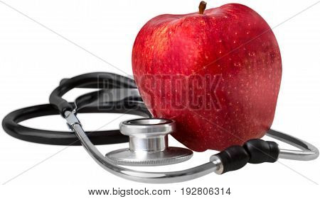 Red apple stethoscope green white background equipment